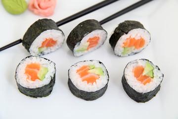 Futomaki, salmon and avocado. Traditional japanese sushi rolls