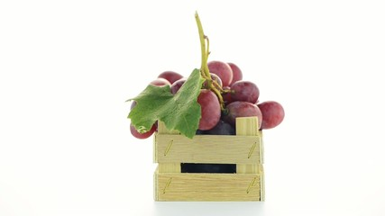 Red grapes in wooden crate