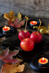 apples for Halloween, candles and maple leaves