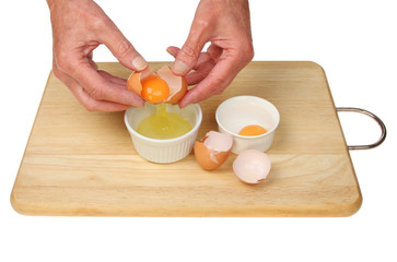 Hands separating eggs