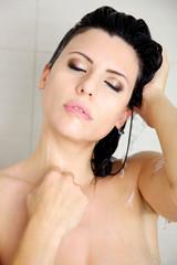 beautiful woman enjoying her shower