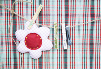 clothespins on a rope, checkered background