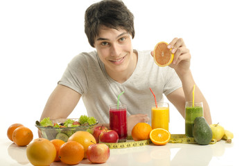 Man having a table full of organic food,juices and smoothie
