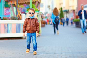 stylish happy boy walking the crowded street