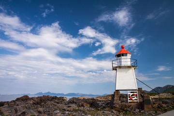 beautiful lighthouse on the edge of rocky sea coast