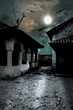 Scary dark courtyard in the ominous moonlight night in a cold Ha