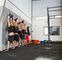 People Doing Handstands At Cross Training Box