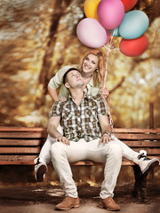 Woman with  balloons surprised by a man