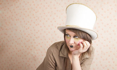 woman in white top hat and a creative makeup