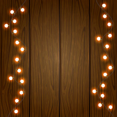 Christmas light on wooden background
