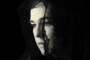 Middle Eastern woman portrait looking sad with black hijab artis