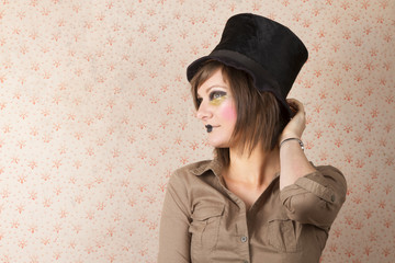 young woman in black hat