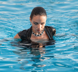 woman in black dress  in a swimming pool