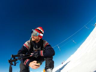 skier sitting waiting to start skiing