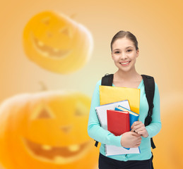 smiling student girl with books and backpack