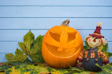 Scarecrow and natural Halloween pumpkin
