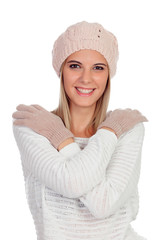 Attractive young caucasian woman in warm clothing in studio