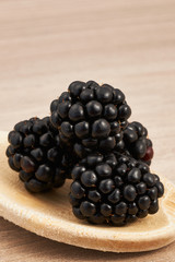 blackberries on a wooden spoon