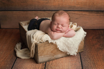 Sleeping Baby Boy in Wooden Crate