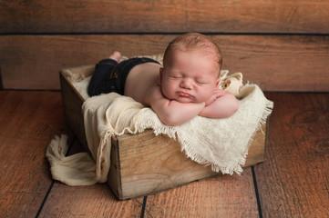 Sleeping Baby Boy in Wooden Crate