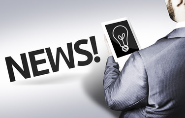 Business man with the text News in a concept image