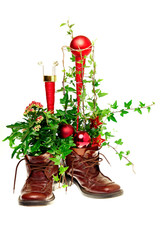 Christmas decoration with shoes, christmas ornaments and ivy