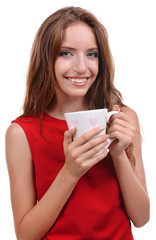 Beautiful young girl with cup of coffee on white background