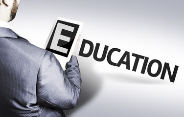 Business man with the text Education in a concept image