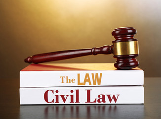 Books of Law on table on brown background