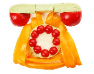 Healthy eating. Retro phone made of vegetables, isolated