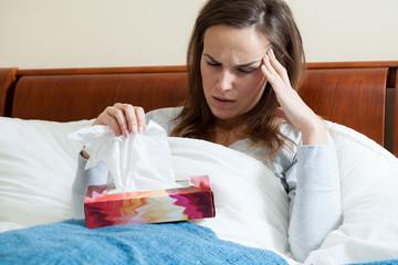 Ill woman feeling pain