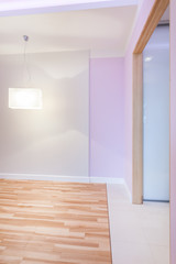 Bright empty room with violet walls