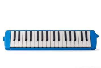Musical melodica isolated on white background.
