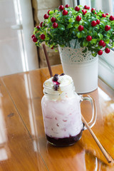 blueberry milk soda in glass mug