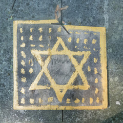 Star of david as seen in a jewish cemetery in poland.