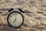 Alarm clock on the beach