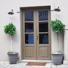 Athens Greece, traditional tavern entrance and flower pots
