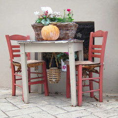 "Athens Greece, basket with flowers ""served"" on traditional table"