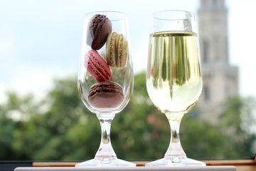 Two glasses of French macarons and white wine