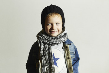 little boy in scarf and jeans.winter.funny child.smiling happy