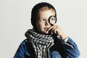 funny child learns the world.fashion little boy in scarf.winter