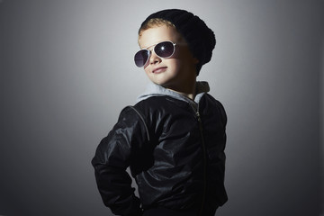 Smiling Little boy.Fashionable child in sunglasses.Black cap