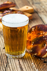 Refreshing beer ready to drink and fresh bavarian pretzels