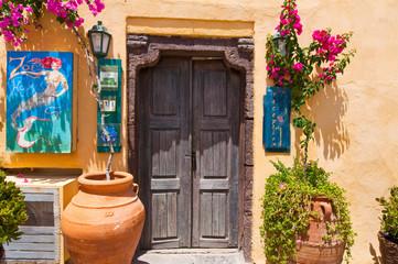 Local hotel on the Oia street. Santorini, Greece.