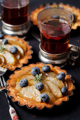 Homemade pear and blueberry tarts