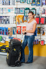 Woman Holding Tool Case In Hardware Store