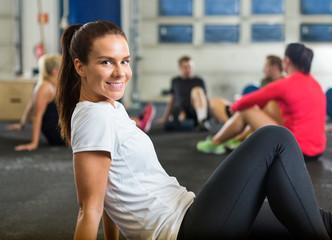 Smiling Woman Exercising In Cross Training Box
