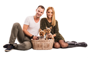 Love Couple with two yorkshire terrier in basket