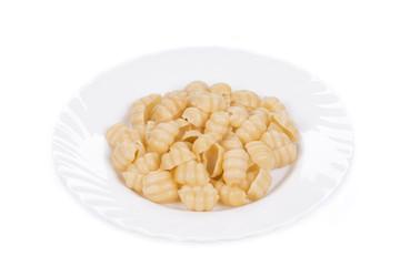 Close up of pasta cavatappi on white plate.