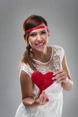 Smiling Pretty Woman Holding Red Heart